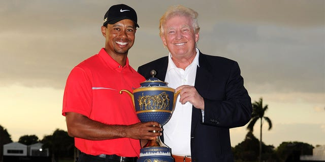 DORAL, FL - MARCH 10: Tiger Woods and Donald Trump pose with the Gene Sarazen Cup after his two-stroke victory during the final round of the World Golf Championships-Cadillac Championship at TPC Blue Monster at Doral on March 10, 2013 in Doral, Florida. (Photo by Stan Badz/PGA TOUR)