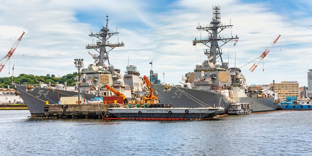 American Arleigh Burke-class destroyer USS John S. McCain DDG-56 and USS Curtis Wilbur DDG-54 of the United States Navy berthed in the Japanese Yokosuka naval base.