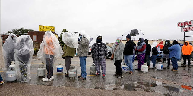 People wait in line to fill propane tanks Wednesday, Feb. 17, 2021, in Houston.
