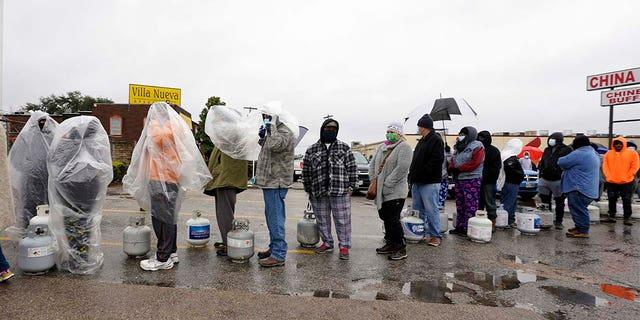 People wait in line to fill propane tanks Wednesday, Feb. 17, 2021, in Houston. (AP Photo/David J. Phillip)