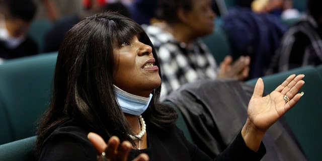 A congregant of the Faith Center Church lifts her hands toward the sky as she worships with others in Bluefield, W.Va., on Saturday, Jan. 24, 2021. (AP Photo/Jessie Wardarski)