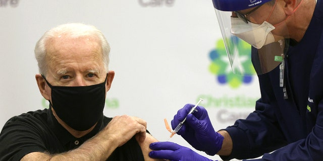 FILE - President-elect Joe Biden receives the second dose of a COVID-19 Vaccination from Chief Nurse Executive Ric Cuming at ChristianaCare Christiana Hospital on Jan. 11, 2021. (Photo by Alex Wong/Getty Images)