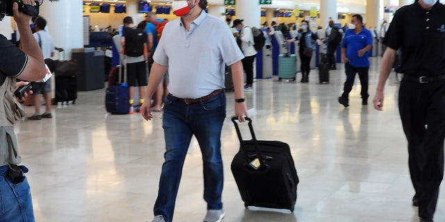 Sen. Ted Cruz (R-TX) checks in for a flight at Cancun International Airport after a backlash over his Mexican family vacation as his home state of Texas endured a Winter storm on February 18, 2021 in Cancun, Quintana Roo, Mexico. (Photo by MEGA/GC Images)