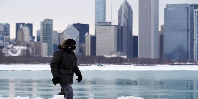 A man is bundled up against the cold in Chicago on Sunday. (AP)