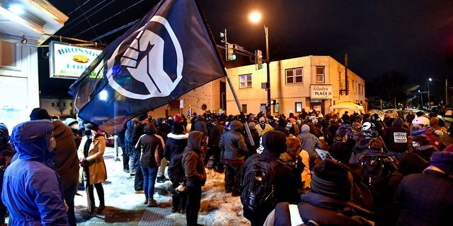 A crowd gathers near the site of Daniel Prude's encounter with police officers in 2020, in Rochester, N.Y., Tuesday, Feb. 23, 2021. (AP Photo/Adrian Kraus)