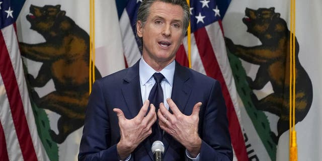 FILE - In this Jan. 8, 2021, file photo, California Gov. Gavin Newsom outlines his 2021-2022 state budget proposal during a news conference in Sacramento, Calif. About a year after the state's first coronavirus case, Newsom has gone from a governor widely hailed for his swift response to a leader facing criticism from all angles. (AP Photo/Rich Pedroncelli, Pool, File)