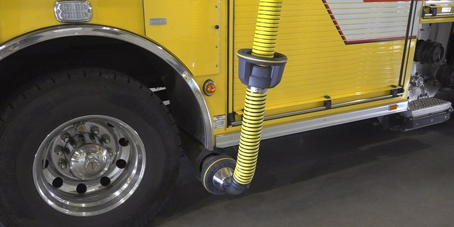The Goodyear Fire Department has a bright yellow hose hooked up to their fire trucks exhaust, which will then redirect the harmful fumes up and out of the station.