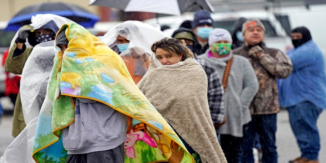 People wait in line to fill propane tanks on Wednesday in Houston. (AP)