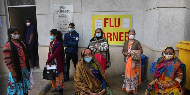 People wait outside a health center to get tested for COVID-19 in New Delhi, India, Thursday, Feb. 11, 2021. (Associated Press)