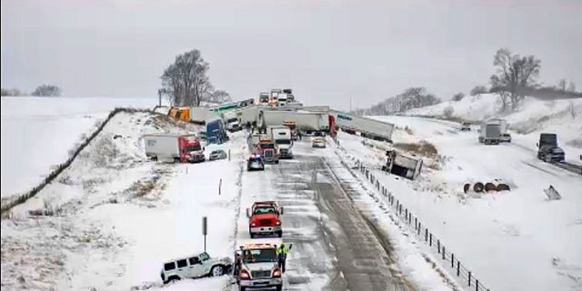 This image provided by the Iowa Transportation Department from a traffic camera shows a massive pileup on Interstate 80 on Thursday, west of Newton. The eastbound lanes of the interstate were closed following the chain-reaction crash, which involved roughly 40 vehicles. (AP/Iowa Transportation Department)