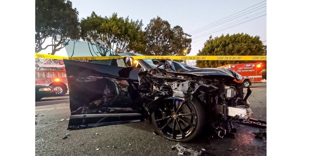 The driver of this black Lamborghini SUV sustained head injuries and was transported to a local hospital.
