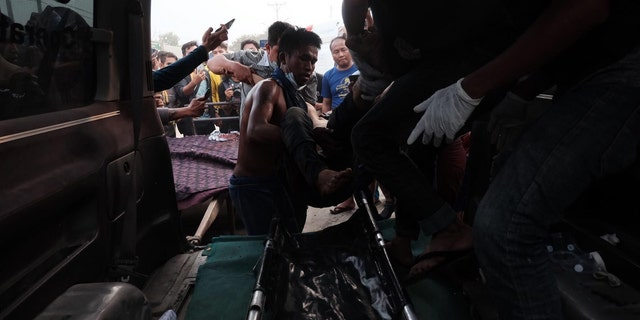 Burma protest against military coup leaves at least 2 dead, dozens injured