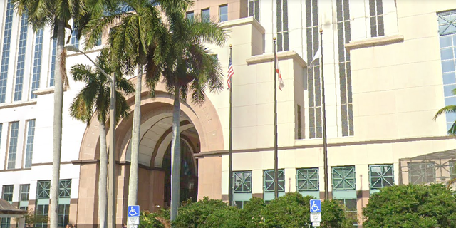 The flags outside of the Palm Beach County Courthouse. (Google Maps)
