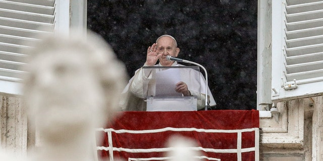Pope Francis delivers his blessing from his studio window overlooking St. Peter's Square, at the Vatican, Sunday, Feb. 7, 2021. (AP Photo/Gregorio Borgia)