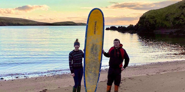 Stephanie Riise, 22, and Jake Anderson, 23, found this 9-foot surfboard while they were on a walk on Dec. 28.