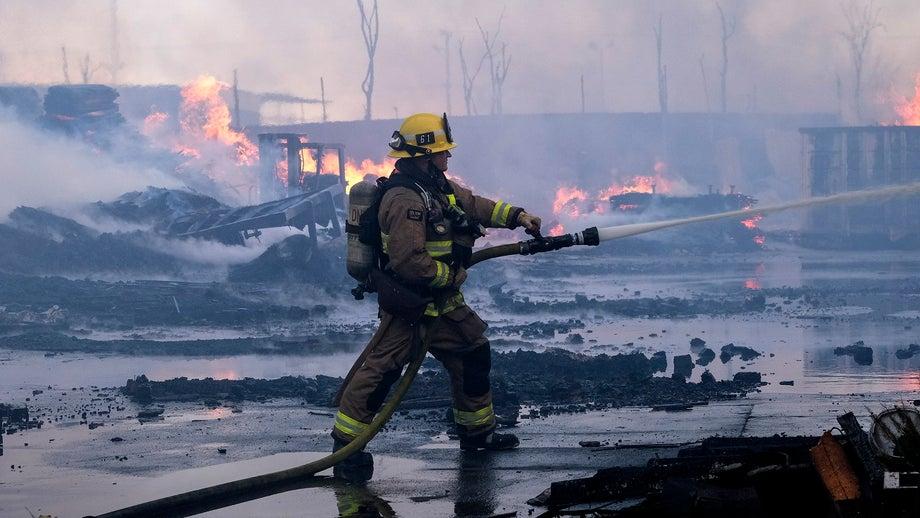 Massive fire tears through Compton