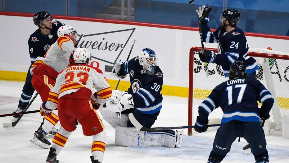 Winnipeg builds early 2-goal edge, beats Calgary 3-2