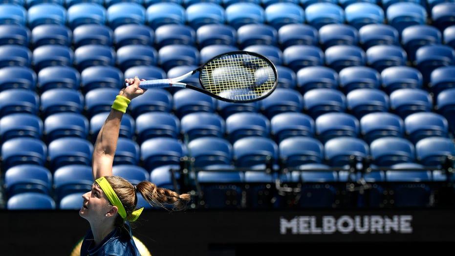 Australian Open goes quiet as lockdown keeps crowds away