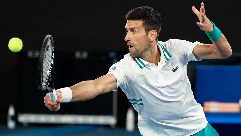 Injured Djokovic advances to quarters at Australian Open