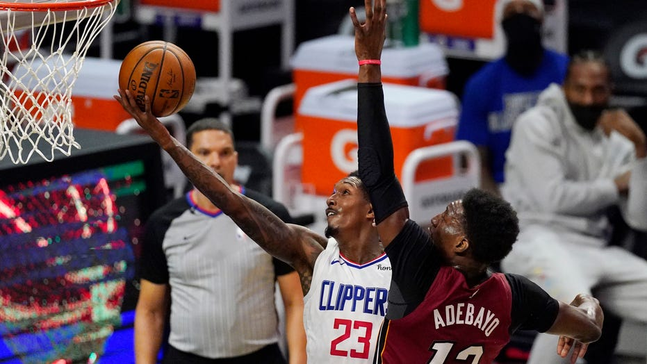 Morris comes up big in Clippers' 125-118 win over Heat