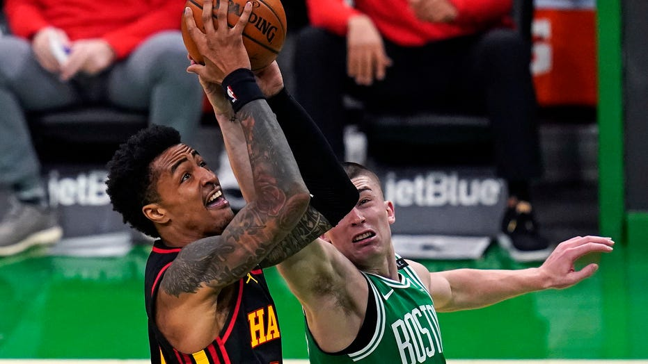 Young scores 40, Hawks end skid, slip by Celtics 122-114