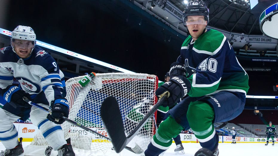 Laurent Brossoit makes 29 saves, Jets beat Canucks 2-0
