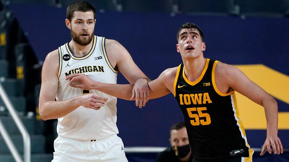 Dickinson impresses as No. 3 Michigan routs No. 9 Iowa 79-57