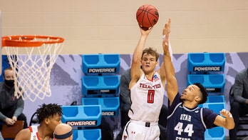 Texas Tech uses 2nd-half surge to get past Utah State 65-53