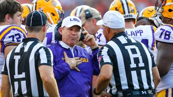 Kansas places coach Les Miles on administrative leave after LSU report
