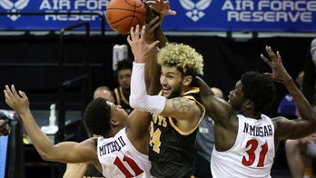 No. 19 San Diego State holds off Wyoming 69-66 in MW tourney