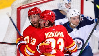 Gaudreau responds with 2 assists as Flames beat Jets 4-2