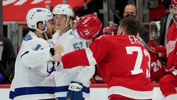 Red Wings' Adam Erne goes down hard after fight with Lightning's Barclay Goodrow