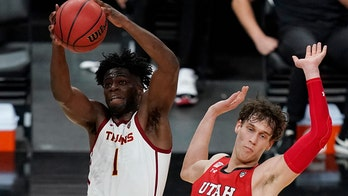 No. 24 USC holds off Utah 91-85 in double overtime at Pac-12