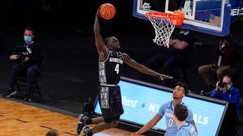 Ewing, Georgetown take Big East, NCAA bid with stunning rout