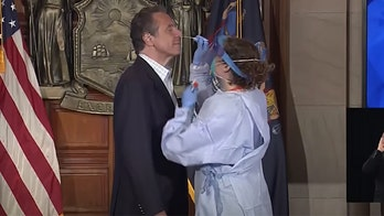 NY Gov. Cuomo's creepy COVID test comments resurface: 'You make that gown look good'