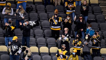 NHL team under fire for photoshopping masks on to fans in social media photo