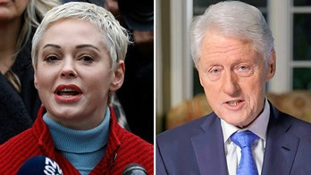 Rose McGowan accuses Twitter of 'trying to silence me' by suspending her over tweet attacking Bill Clinton