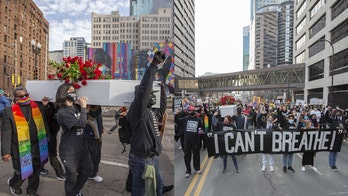 Minneapolis protesters carry casket, march through city on eve of Chauvin trial
