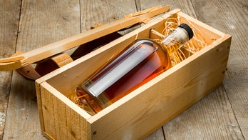 Contractor finds secret message, bottle of whisky from old homeowners beneath floor