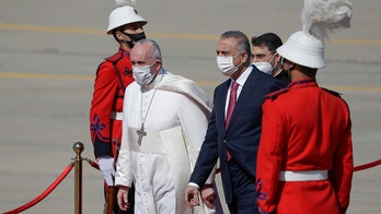 Pope begins first-ever papal visit to Iraq, urges Christians to help rebuild country