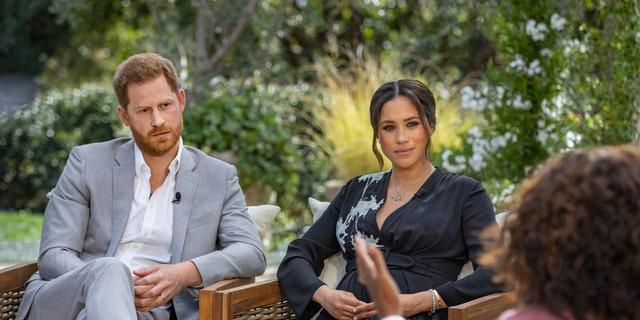 Prince Harry and Meghan Markle speak with Oprah Winfrey. (Joe Pugliese/Harpo Productions via AP, File)