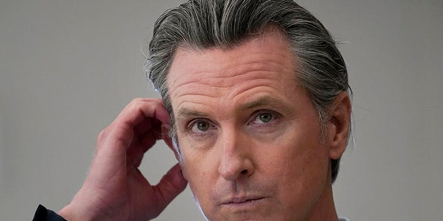 California Gov. Gavin Newsom listens to questions while speaking at a news conference at Ruby Bridges Elementary School in Alameda, Calif. (AP Photo/Jeff Chiu)