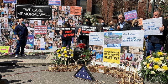 Protesters against Gov. Andrew Cuomo's handling of nursing homes COVID-19 deaths, gather outside Cobble Hill Health Center nursing home on Sunday, March 21, 2021 in New York. (AP Photo/David Crary)