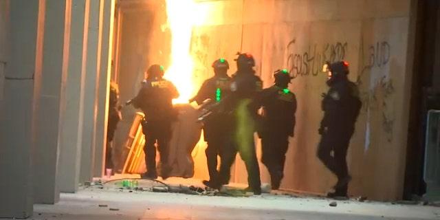Law enforcement officers deployed in Portland, Oregon, on Thursday night. (FOX 12 Oregon)