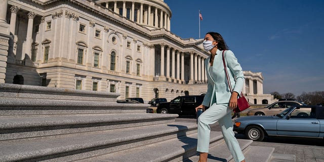 Representative Alexander Ocasio-Cortez (D-NY) walks to the House of Representatives on Capitol Hill in Washington, DC, Thursday, March 11, 2021. The fiery liberal member of the House of Representatives called for trillions of dollars more spending than President Biden had proposed during his tenure.