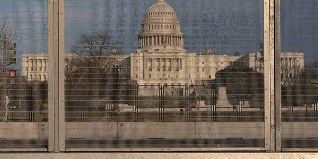 A section of fencing blocking the Capitol grounds is seen at sunset, on March 1 along a section of 3rd St that has had razor wire temporarily removed in Washington.remove portions of perimeter fencing erected around the Capitol (AP Photo/Jacquelyn Martin)