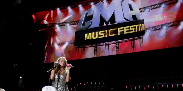 FILE - CMA Fest will be canceled for a second year in a row due to the COVID-19 pandemic. Miranda Lambert is pictured here performing at the music festival in Nashville, Tenn. on June 12, 2011. (AP Photo/Wade Payne, File)