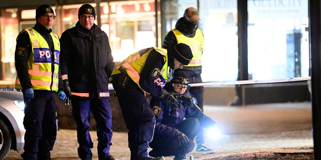 Police are seen in the area after several people were attacked in Vetlanda, Sweden, Wednesday, March 3, 2021. (Mikael Fritzon/TT News Agency via AP)