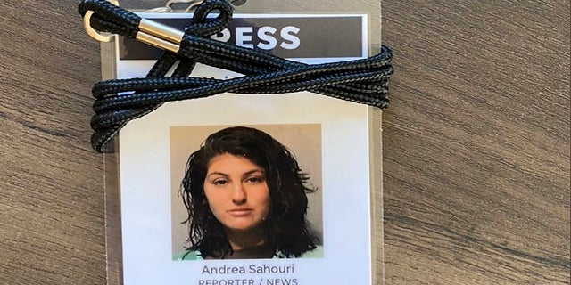 A press badge for Des Moines Register reporter Andrea Sahouri features her jail booking photo from her May 31, 2020 arrest while covering a Black Lives Matter protest. (Photo courtesy Andrea Sahouri via AP)