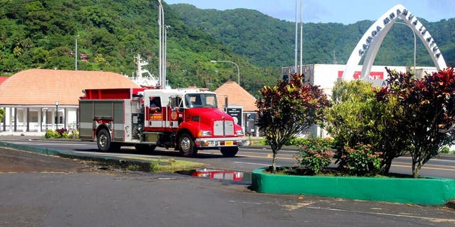 A firetruck tells people along the road, through a public address system (PA) to move to higher grounds following a tsunami warning for American Samoa in Pago Pago, Thursday, March 4, 2021. (AP Photo/Fili Sagapolutele)